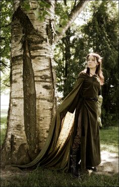 Long tunic with leggings, boots, and cape. LOVE! (Ok. Can you tell I've been watching Robin Hood and am really excited for Brave? Yeah? Huh.)