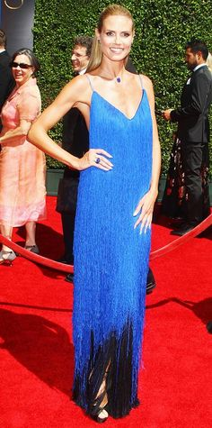 AUGUST 18, 2014 Project Runway host Heidi Klum stole the spotlight at the 2014 Creative Arts Emmy Awards in a custom blue fringed creation by Project Runway contestant Sean Kelly, which swished with her every step. She color-coordinated her look with Lorraine Schwartz sapphire jewelry.