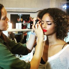 """""""The Topshop Look- @hannah_murray1 putting the finishing touches to @malaikafirth using #TopshopBeauty Matte Lip Bullet in 'Boyracer' on lips and on eyes…"""""""