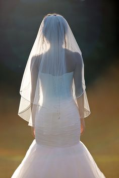 Without the blusher.  Fingertip veil with blusher double tier by CoutureBrideBoutique
