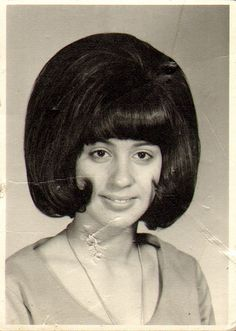 The higher the hair, the closer to God.  This girl was apparently a modern-day prophet back in 1964.