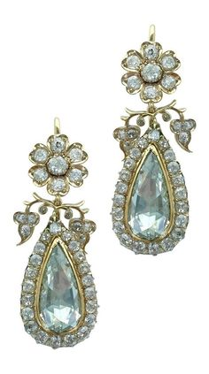 An impressive pair of antique gold and foil-backed diamond earrings.