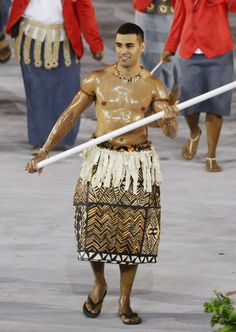 This is taekwondo player Pita Taufatofua, leading Tonga's team of seven athletes. | Tonga's Oiled Up Flag Bearer Was The Highlight Of The Opening Ceremony