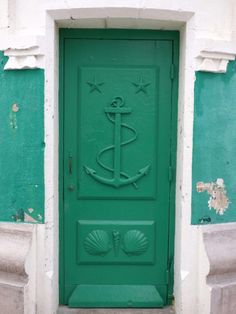 "🔴  ""Green door of the lighthouse by Nicolas M on 500px.""    (Location not provided.)               NOTE: PRESS ""VISIT"" TO SEE PHOTOS OF TRAVEL & NATURAL SCENERY, ANIMALS, FLOWERS, & MORE.   (This is the only door/window image I saw.)"