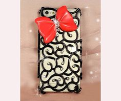 This phone case is decorated with a red bow with some black lace type decoration