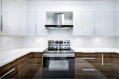 Modern kitchen with two tone cabinets and matching quartz countertops and backsplash Quartz Backsplash, Subway Tile Backsplash, Quartz Countertops, Kitchen Backsplash, Kitchen Appliances, Modern Kitchen Design, Kitchen Designs, Kitchen Island Materials, Two Tone Cabinets