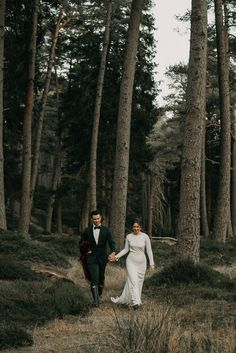 Moody couple portraits taken amid forest | Image by Sophia Veres Photography