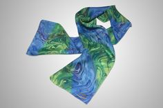 Tide Winds Silk Scarf: Multiple shades of light blue and green, cobalt, plum swirl and whirl across the silk like ribbons in a breeze. [ ColorVibeDesigns.com ] #swirl #silk #scarf