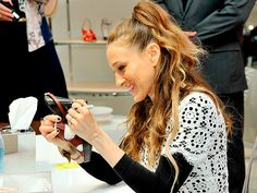 Star Tracks: Friday, March 7, 2014 | SIGN, SEALED, DELIVERED | Sarah Jessica Parker autographs the heel of a customer's shoe during a signing event for her new SJP collection inside Nordstrom at L.A.'s The Grove on Thursday.