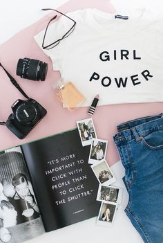 Flatlay Styling ideas | Flat lay photography inspiration | Clothes, camera, magazine, perfume, girl power t-shirt and jeans.