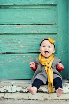 Oh goodness... how cute it this little girl! I love the rustic-ness of the background, the happiness she exudes and the bright pop of color!
