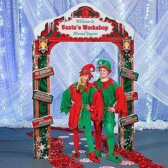 Our Santa's Workshop Personalized Arch has the looks of the outside of Santa's Workshop with the vibrant green, red and white colors and signs pointing in all directions.
