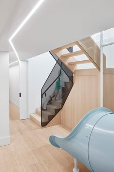 """The slide was designed by Reflect Architecture to animate the lower-level so that it did """"not feel like a basement"""" and to also help bring in natural light via the large opening that it required."""