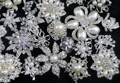 Brooches for wedding! These are made with crystal rhinestones with faux pearls. You will receive beautiful 40pcs brooches,These are pre-assorted sets,contain duplicate brooches. You can not choose specifics etc. The most of brooches are in stock, will be instead of similar