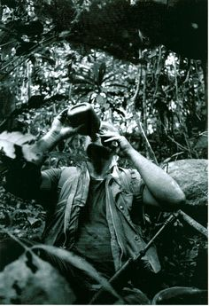 """""""Unidentified Marine lieutenant taking a drink of water while on an operation in the mountains of western Quang Nam province with H/2/5 in early 1969.""""  From the Barry Broman Collection (COLL/4613) at the Archives Branch, Marine Corps History Division  OFFICIAL USMC PHOTOGRAPH"""
