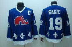 Nordiques #19 Joe Sakic Stitched CCM Throwback Blue NHL Jersey