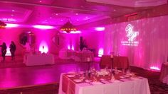 Lots of pink in this one. 20 foot lighted backdrop with pink wireless led uplighting,  water projection and gobo projection.