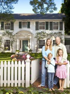 Homeowners in Front of White Colonial House