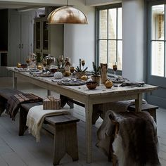 Gold and bronze Christmas dining room with statement lamp