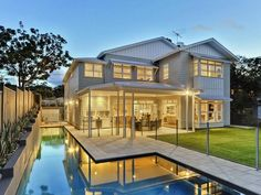 fusion of traditional Queensland architecture with crisp, elegant Hamptons style