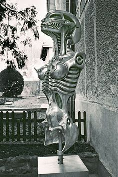 Biomechanoid 2002  Aluminum, 150 x 53 x 57cm  ©2002 H.R. Giger  at entrance of the Giger Museum  Photo: ©2006 Dave Julian