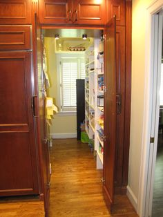 Hidden Pantry, looks like cabinets Kitchen Wall Cabinets, Kitchen Redo, Kitchen Remodel, Kitchen Ideas, Kitchen Cupboard, Hidden Pantry, Hidden Kitchen, Food Storage Cabinet, Kitchen Storage