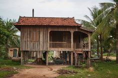 https://flic.kr/p/QREN7N | House on stilts, Krakor, Cambodia | This kind of house is typical from Cambodia. Some modern ones are in concret but still on stilts.  The earth road going through the countryside around Krakor village was very nice to walk through since every 50 meters was animated by a life scene.