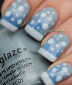A snowy manicure (by mynailpolishonline).  She did the sky as a subtle, blueish grey gradient with China Glaze's Sea Spray & Orly's Snowcone.  Then she added the snow on the ground as a white funky French & some white randomly sized & placed dots representing the snow falling down