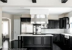 Cooking up a storm: It comes as no surprise that keen cook Kylie worked extensively on her kitchen, which also features a monochrome theme