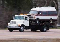 Resultado de imagen para gruas trasladando vehiculos