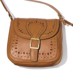 """Covered in cutouts, this adorable crossbody also beats out other bag options because of its ideal size. 7 1/2"""" W x 7 3/4"""" H x 2 3/4"""" D (55"""" L max adjustable strap)"""