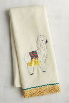 Just to be clear, Pier 1's Llama Embroidered Guest Towel was not embroidered by llamas. Our cotton towel features an embroidered llama and a decorative hem, making it a fun addition to your bathroom, or a great gift for any llama lovers you may know.