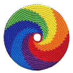 Pocket Disc Rainbow Swirl Sports: The Sports Edition Pocket Discs are heavier, fly farther, are colorfast and are more geared towards outdoor play. The Pocket Disc is a soft, crocheted throwing disc that flies straight with ease and has a remarkable story Rainbow Crochet, Rainbow Swirl, Cotton Crochet, Knit Crochet, Crochet Throws, Crochet Humor, Crochet Afghans, Double Crochet, Crochet Stitches