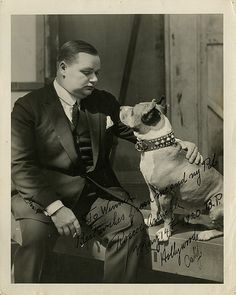 Roscoe Conkling Arbuckle a.k.a. Roscoe 'Fatty' Arbuckle (1887-1943) and his pet dog Luke (1913-1926) .  Luke was a Staffordshire Bull Terrier that performed  in American silent comedy shorts between 1914 and 1920.  Roscoe was an American silent film actor, comedian, director, and screenwriter.