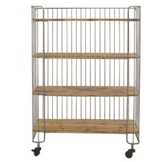 The Wire Frame Storage Shelf with Casters is great for extra storage in any room of the house. Featuring a simple wire frame design and casters for mobility. Colors/finish: Silver Materials: Iron, woo