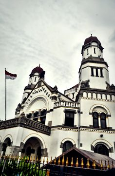 "Lawang Sewu is a landmark in Semarang, Central Java, Indonesia. The colonial era building is famous as a haunted house, though the Semarang city government has attempted to rebrand it... The name Lawang Sewu is from Javanese; it means ""Thousand Doors"". The name comes from its design, with numerous doors and arcs. The building has about 600 large windows.."