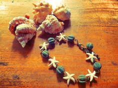 Plumeria Green Coral Bracelet  Starfish stones and green coral beads in vintage chain Like us on https://www.facebook.com/plumeriajewelry to purchase.