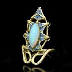 A beautiful gold, opal and enamel ring by Lalique, a rare and attractive ring designed as a sinuous gold vine which encircles the finger and develops into an elongated stylised leaf motif in blue-green plique-a-jour enamel, rub-over set to the cen Lalique Jewelry, Opal Jewelry, Jewelry Art, Vintage Jewelry, Fine Jewelry, Women Jewelry, Gold Jewelry, Art Nouveau Ring, Art Nouveau Jewelry