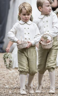 Prince George appeared to be taking his pageboy duties very seriously on Saturday as he helped to sprinkle petals before the bride and groom
