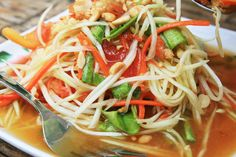Som tam ' spicy papaya salad ' comes from northeast Thailand, but it's reached near-cult status throughout the rest of the country. Slight regional differences in ingredients means placement on the sweet-or-sour scale may vary greatly between restaurants. Common to all recipes is shredded green papaya and a healthy dose of heat. Barbequed chicken and lumps of sticky rice are the perfect companions.