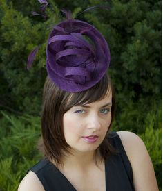 Fascinator - and it's purple. Oh, I wish I dared.