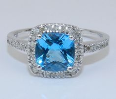 14K White Gold Diamond & CushionCut Blue Topaz Halo by GalaxyGems. , via Etsy.
