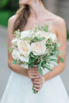 Elegant wedding bouquet idea - light pink peonies and greenery {Courtesy of Laura Kelly Photography}