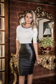 Blonde in black leather pencil skirt and white top