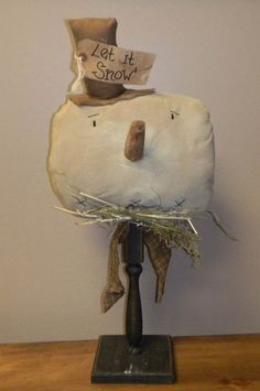 "Primitive Distressed Muslin Snowman Face With Brown Hat on Pedestal 24"" # 5791"