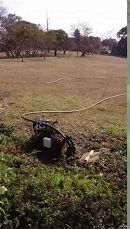 Compressed air to clean sediment from borehole