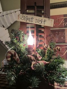 Old Prim Shutter.with pine, candy canes & a candle. Primitive Country Christmas, Country Christmas Decorations, Primitive Christmas, Rustic Christmas, Xmas Decorations, Winter Christmas, Vintage Christmas, Christmas Holidays, Christmas Wreaths