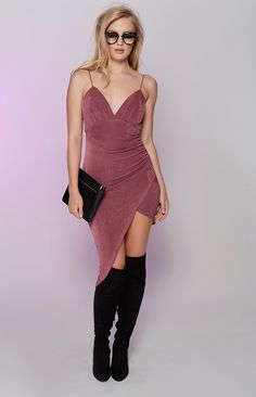 You can try and tame your wild side, but the Lovinia Dress is such a bad influence! Made from a stretchy, textured fabric in a mauve shade, this dress features a padded bust, a v-neckline and a slim, bodycon length with pintuck ruching down the side. It also has an asymmetrical bottom hem, an invisible back zip, thin shoulder straps and a hook and eye clasp. Fall in love with the Lovinia Dress tonight when you style her with black strappy heels, statement earrings and a dark plum lip - the…