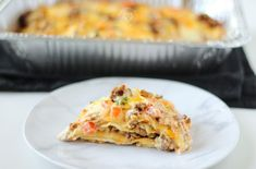 Taco Lasagna is made with soft flour tortillas, seasoned taco ground beef, and pico de gallo. But the cheese is really what makes this Taco Lasagna OVER THE TOP! OVER THE TOP! Chef Recipes, Mexican Food Recipes, Cooking Recipes, Mexican Dishes, Mexican Meals, Retro Recipes, Cooking Ideas, Food Ideas, Party
