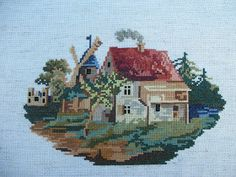 This is Katrina's Cottage by Vintage Designs and the first good sized cross stitch project I've done in a while.  It's also the first tim...